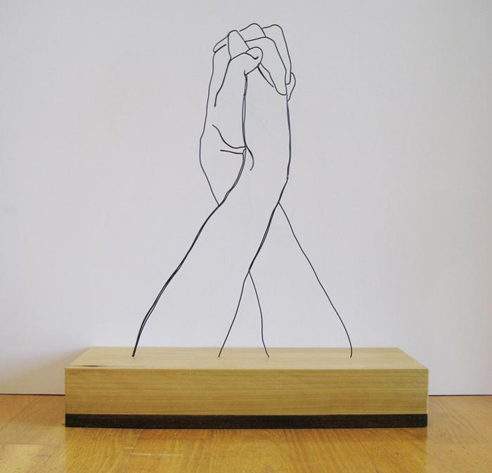 handsclasped Gavin Worth wire sculpture